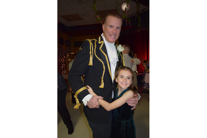 Dressed as Prince Charming, Rob Commissar tries to dress to the theme to make the dance more memorable for his daughter Sky, who is a third grader.