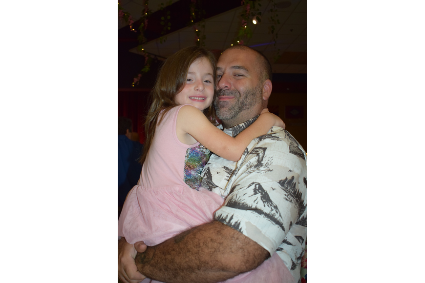 Gwen Frost, a pre-kindergartner, dances with her dad, Pete, during their first daddy-daughter dance. Pete Frost has been to the dance before with his other daughter, Autumn, who is a first grader.