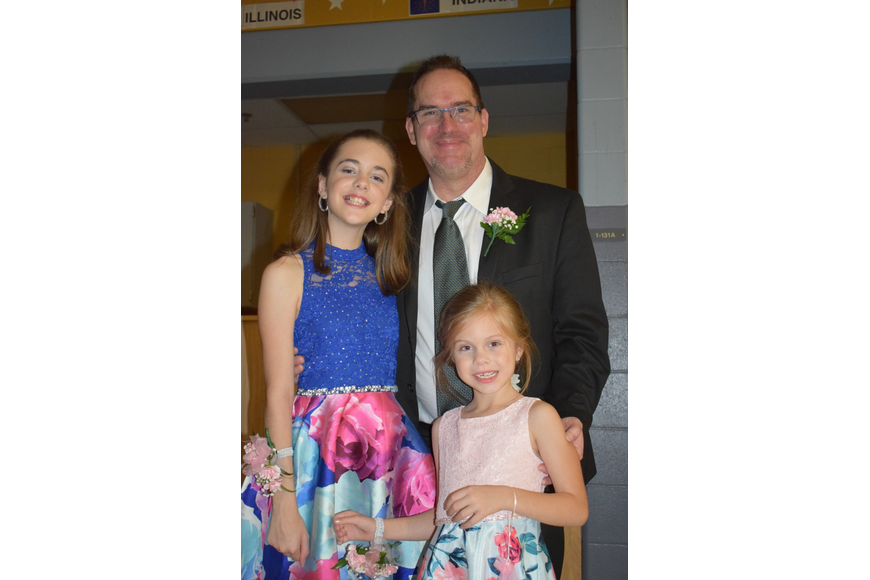 Edan, Matt and Allison Armistead spend time together during the daddy-daughter dance. This year is the only year Edan, a fifth grader, will be at the same school as Allison, a kindergartner.