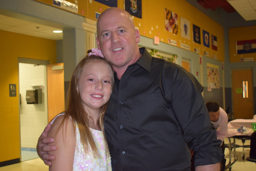 Braelynn Routh, a fourth grader, and Tim Collett have fun during the daddy-daughter dance.