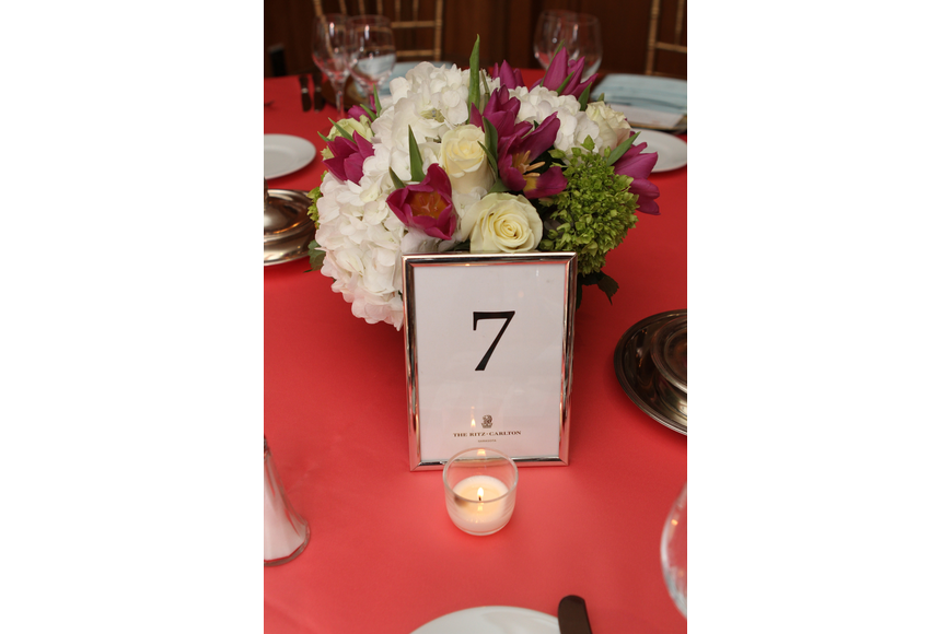 Flowers and other decor lined the tables.