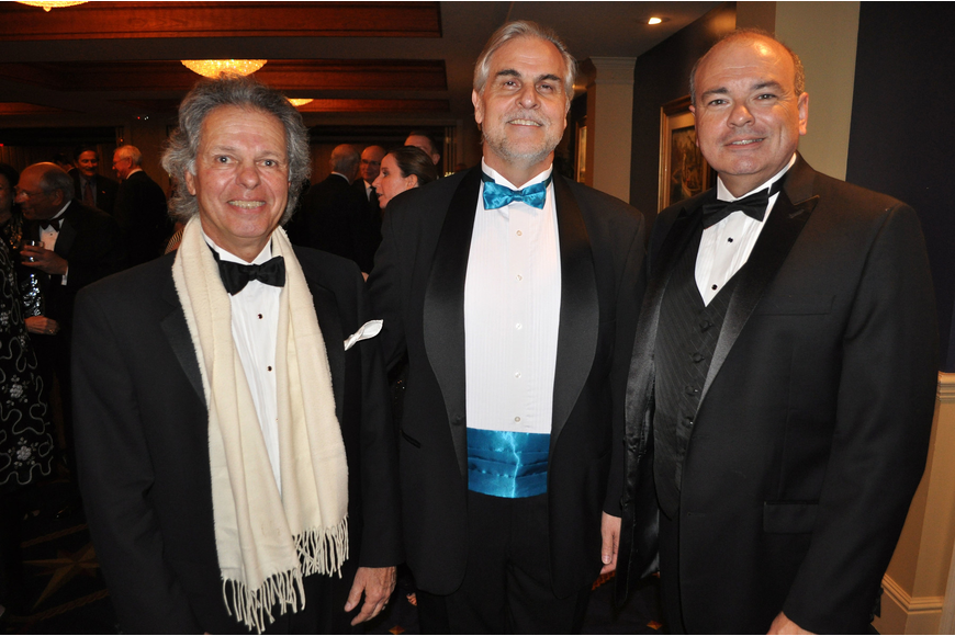 Richard DeGennaro, president of the Bradenton Opera Guild, with Victor DeRenzi, artistic director of the Sarasota Opera, and Richard Russell, executive director of the Sarasota Opera