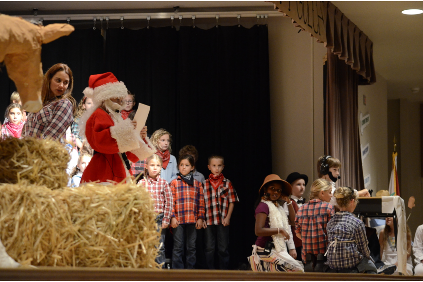 Annalisa Miller as Santa reads the plea from the OK Corral.