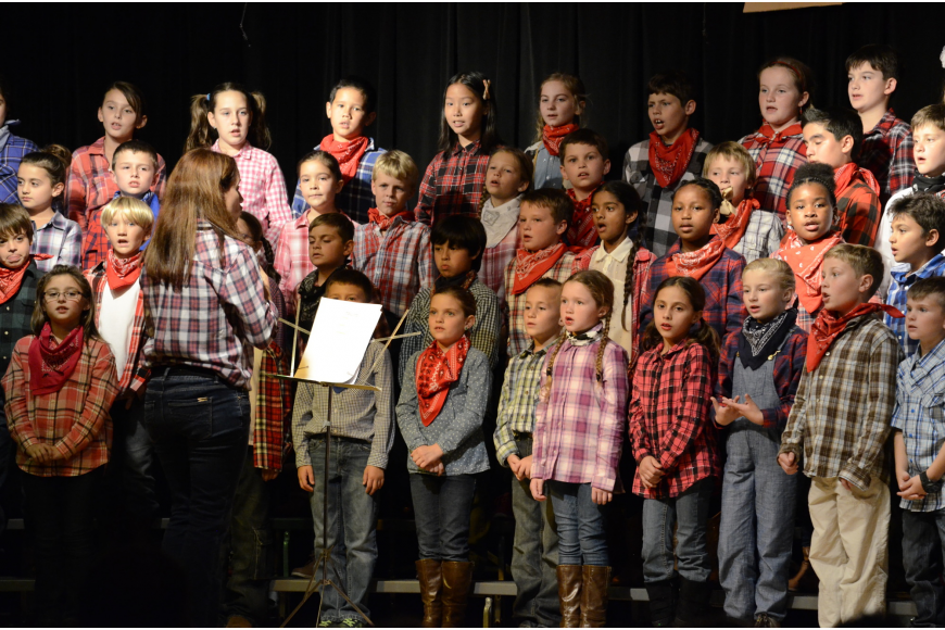Christy Isaacs directs the choir.
