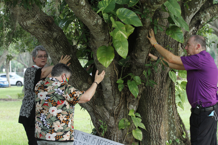 Reverend Elder Lillie Brock and other church members blessed the tree.