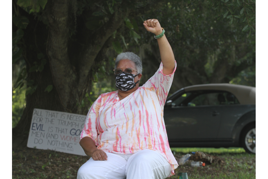 Candy Holmes held her fist up in solidarity.