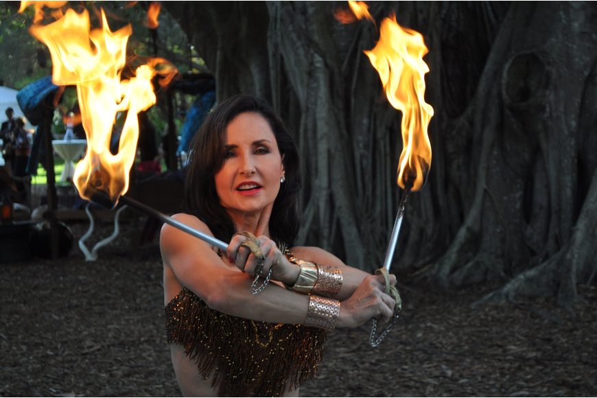 One of the dancers with International Productions by Tahja dances with fire.