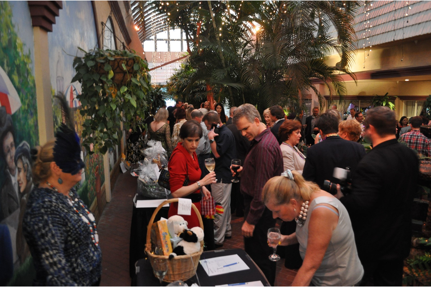 People wandered the courtyard and bid on items at the silent auction.