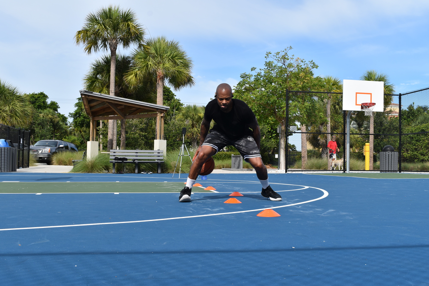 Tim Grant performs a dribbling drill for a client of his on Facebook Live. Grant uses a Bluetooth headset to communicate while livestreaming.
