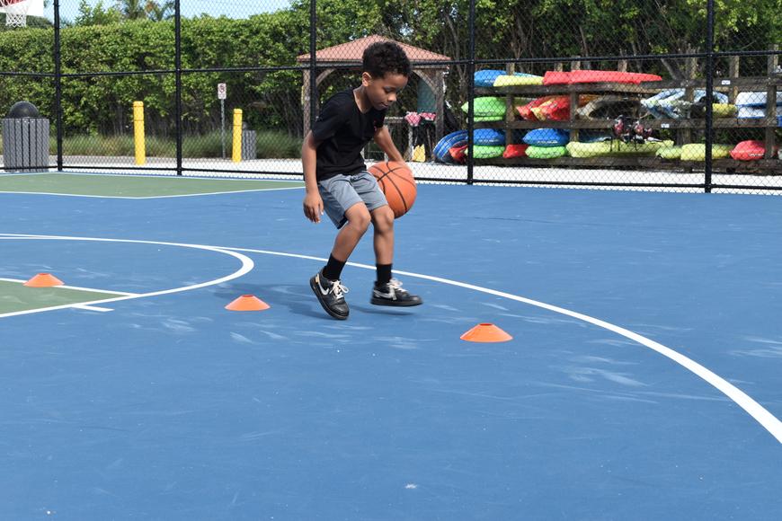 King Grant performs a dribbling drill on Monday, June 22, 2020, at Bayfront Park.