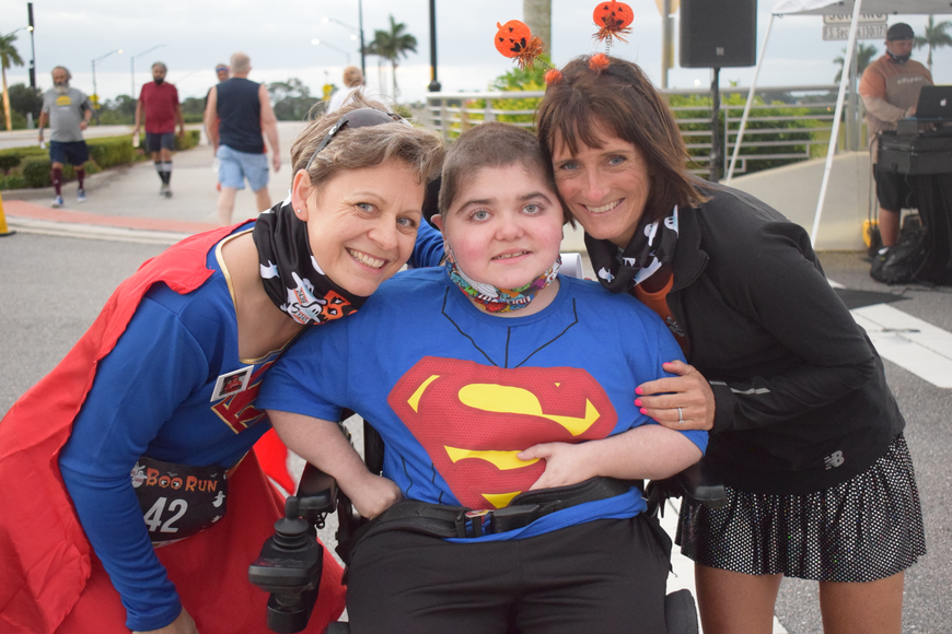 Monaka Oberer, Grayson Tullio and Jennifer Tullio get ready to kick off the annual Boo Run at Nathan Benderson Park Oct. 31. It took a Superman kind of effort to get the race organized in just weeks.