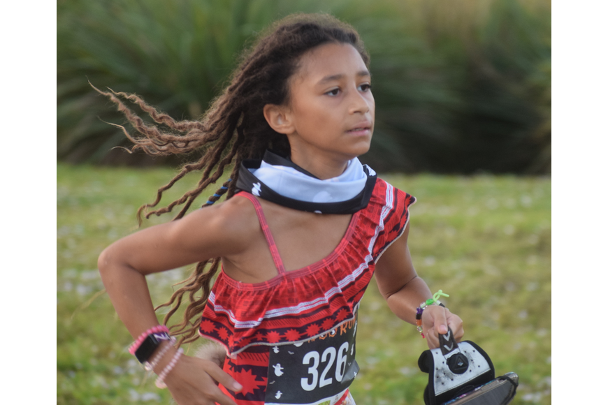 Lakewood Ranch 10-year-old Shadai Magra was the first youth runner to finish the Boo Run. She ran a personal best 25:01.