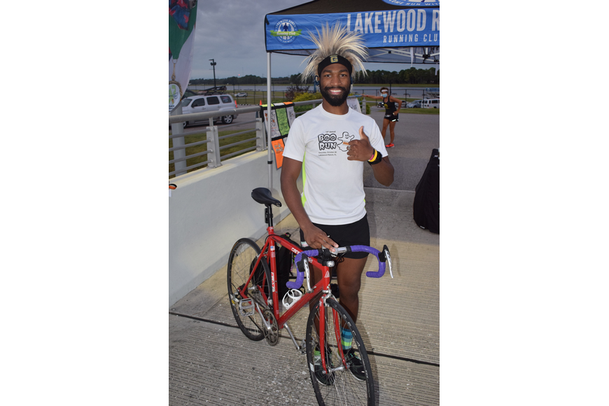 Palmetto's Alvin Ducre is a regular fixture at area benefit runs and he didn't mind riding his bike 19 miles to arrive at Nathan Benderson Park for the Boo Run.