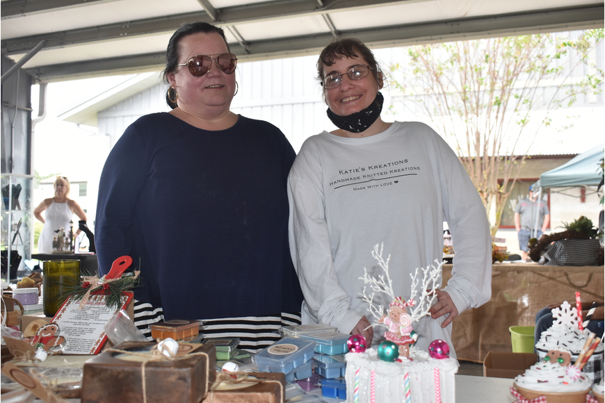 Andrea Riccitelli (left) and Kate Farrens operate the booth for Katie's Kreations, which sells knit hats, blankets, scarfs, soaps and more. Farrens is a participant at Night with the Stars Prom.