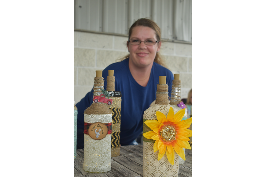 Ashley Garber of Bradenton runs Ashley's Bottle Creations, which creates designs of any theme, including Christmas and other holidays as well as people's names.