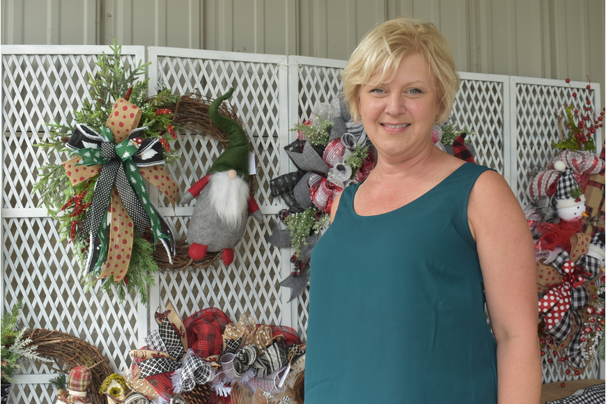 Amy Nowalk of Creekwood makes wreaths for Plank and Vine. She is friends with Night with the Stars Prom community relations director Angela Heck.
