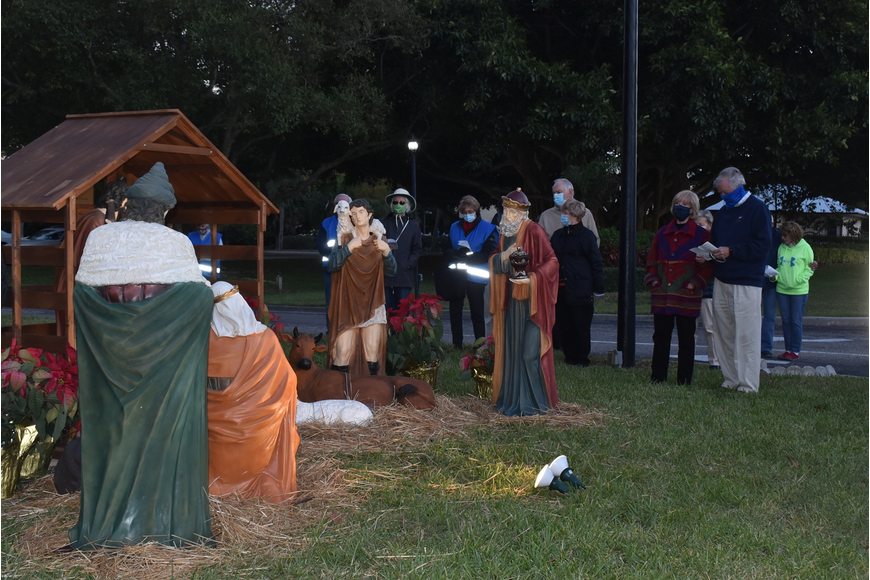 Parishioners gathered around the nativity scene and sang a few Christmas carols together.