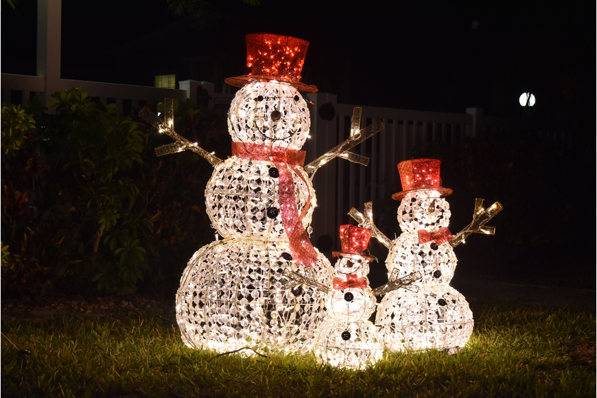 Near the pool, three snowmen made a brave stand in the Florida winter.