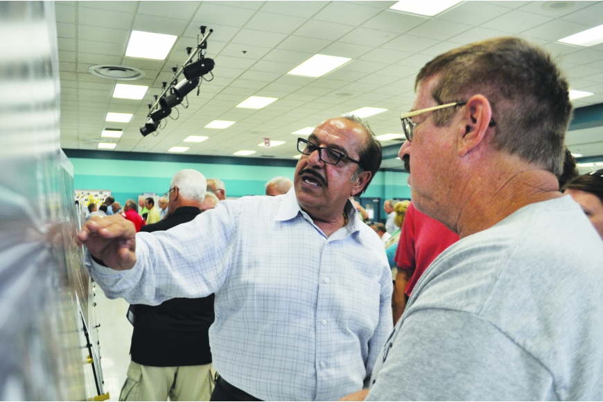 Manatee County employee Sia Mollanazar answers questions about the configuration of future Upper Manatee River Road during a public meeting at Haile Middle School.