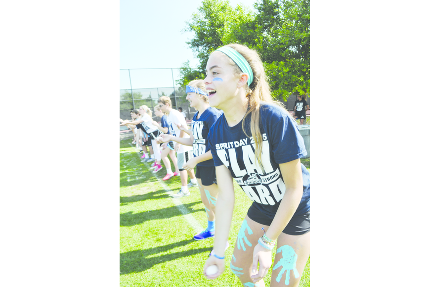 Madisyn Opstal, 13, attempts to gently toss an egg to her partner during The Out-of-Door Academy's Spirit Day.