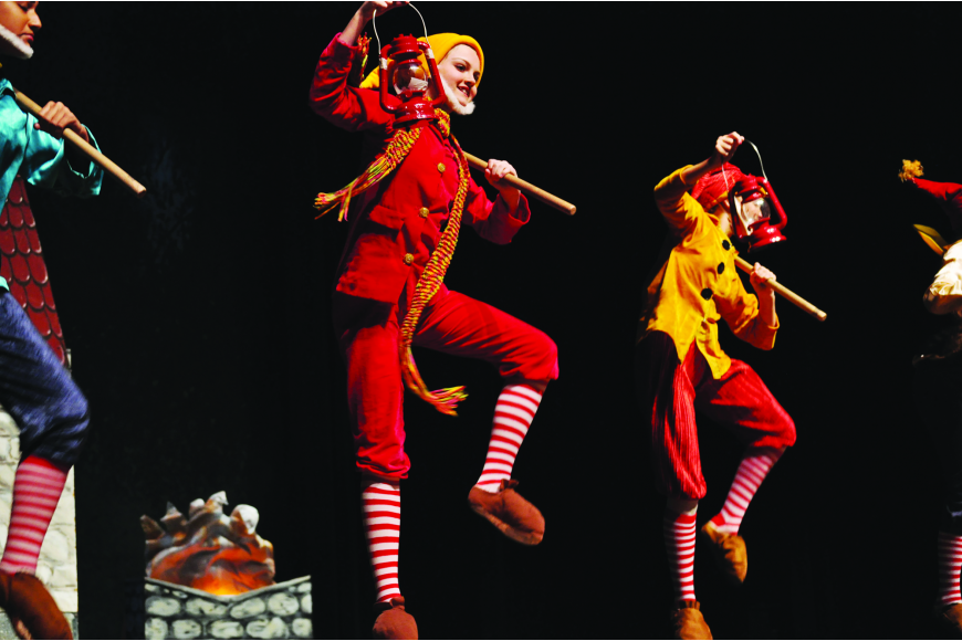 "Alaina Kimsey, as Happy, and Abbey Walsh, as Sneezy, dance joyfully in the Russian School of Ballet's performance of ""Snow White and the Seven Dwarfs."""
