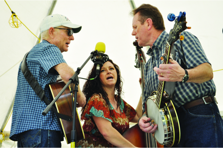 Sonya Stratton and the Straight South performs, including Doug Row on lead guitar, Sonya Stratton on bass and Jeff Folger on the banjo at Linger Lodge Restaurant's Bluegrass Festival and Gumbo Cook-off.