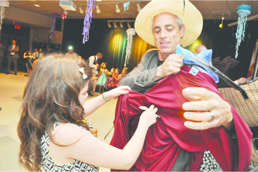 Randy Bezet, right, competes in the dress-up-your-dad contest with his daughter, Emily, during Gene Witt Elementary's father/daughter dance.