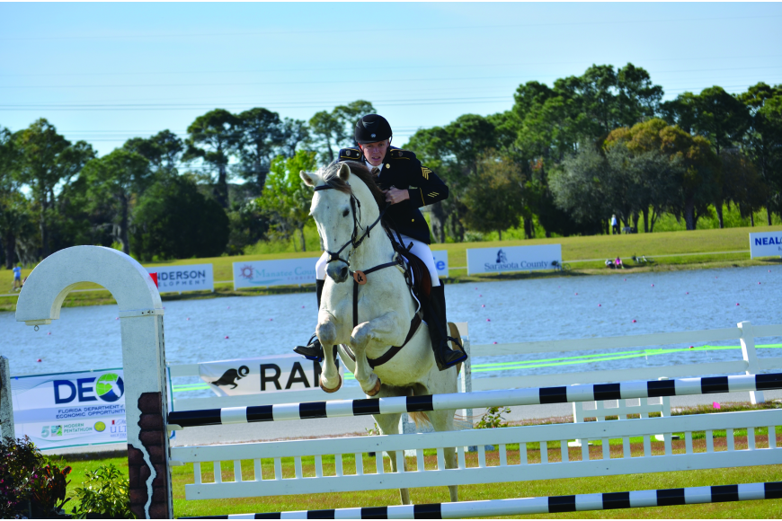 Left: Dennis Bowsher sails over a jump with his horse while competing in the Modern Pentathlon World Cup No. 1.