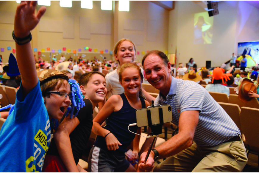 The Rev. Steve Price, right, takes a selfie with Harvest United Methodist Vacation Bible School attendees.