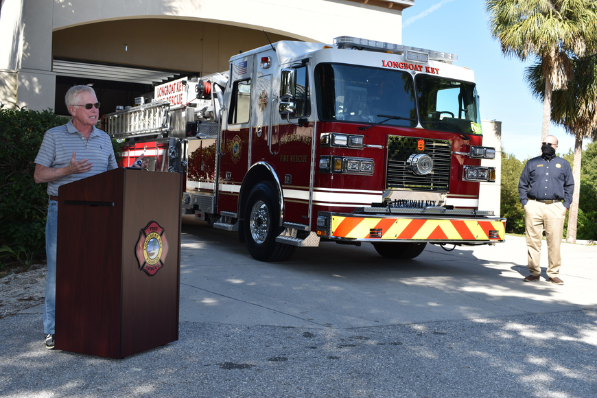 Longboat Key Mayor Ken Schneier spoke during Monday afternoon's fire truck dedication ceremony as Town Manager Tom Harmer looks on.