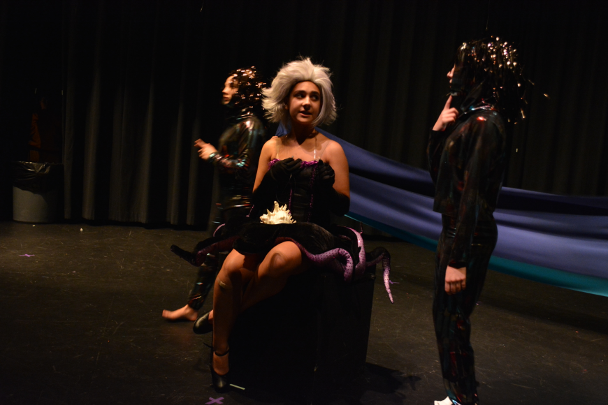 Eels Madisyn Wandall, left, and Ainsley White, right, surround Ursula, portrayed by Sabine Timol.