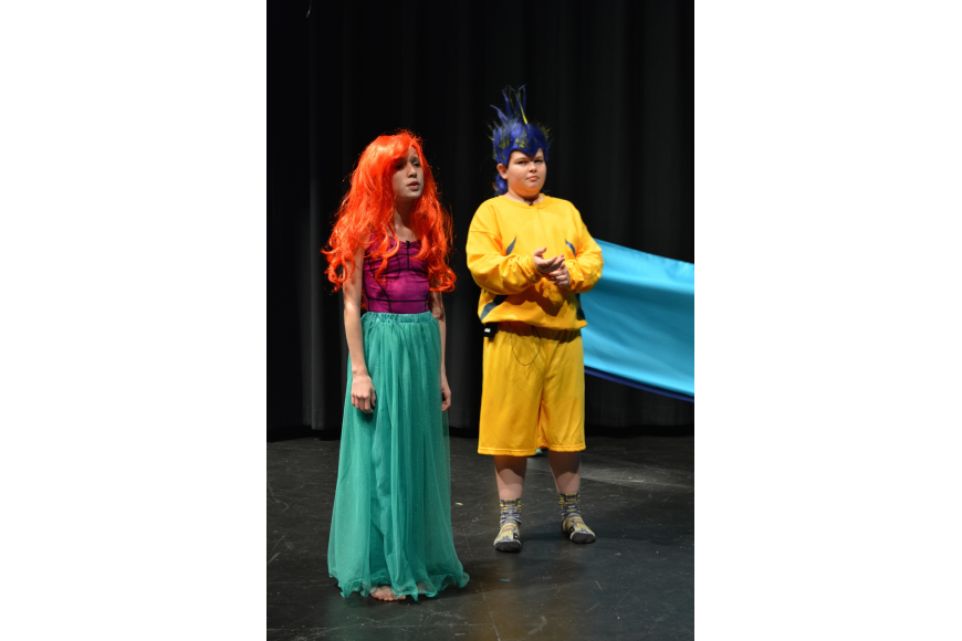 Alexia King, as Ariel, whines about her father's restrictions against seeing humans. Dru Cappar, as Flounder, offers support.