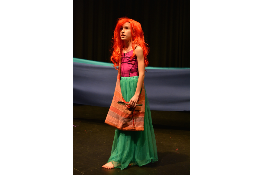 Alexia King, as Ariel, sings about her dreams to explore the human world.
