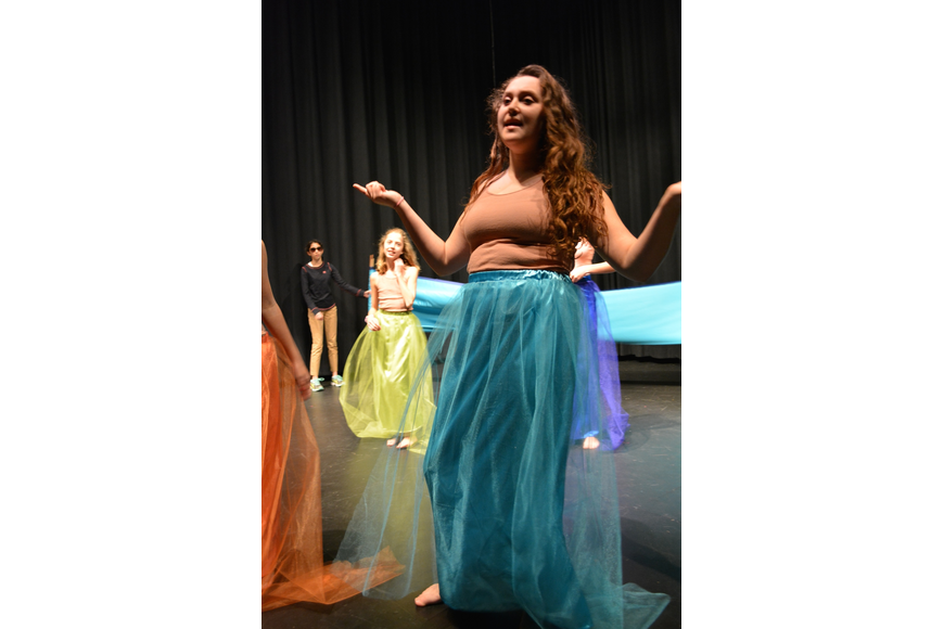 Mermaid Olivia Knego sings that Ariel must be in love because she's been so distracted.