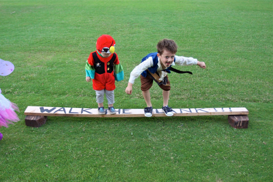 "Camden, 2, and Colt, 5, Chalmers ""walk the plank""."