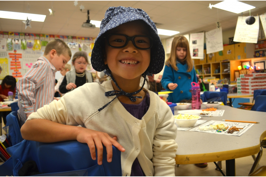 Sophia Greenleaf loves playing dress up and wearing a bonnet and glasses.