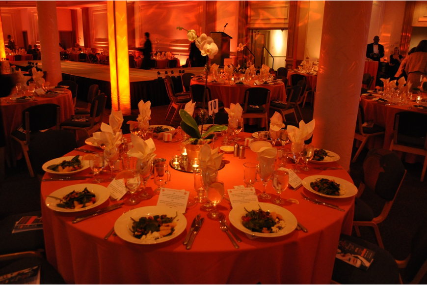 The tables had beautiful orchids as the centerpieces and the room was flooded with orange lighting.