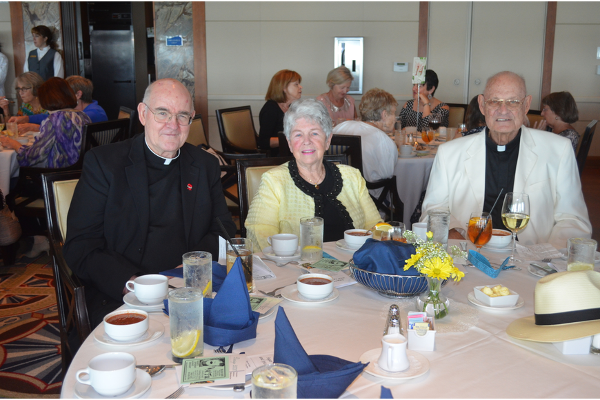 Msgr. Gerry Finegan, Women's Guild President Eileen Hassel and the Rev. Edward Pick