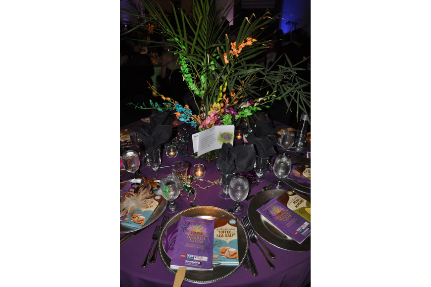 The tables were decorated with, purple tablecloths, plenty of beads and centerpieces by Tropix.