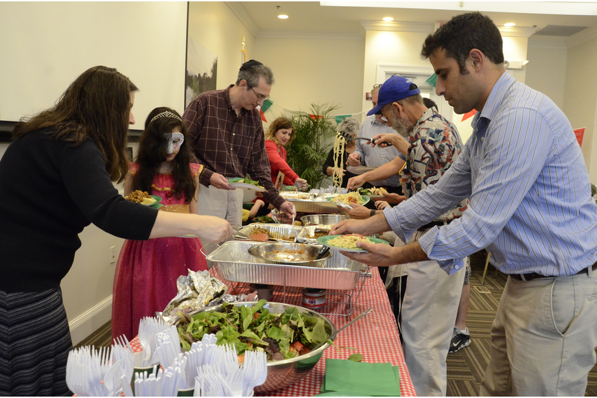 Celebration attendees load up on homemade Italian fare.