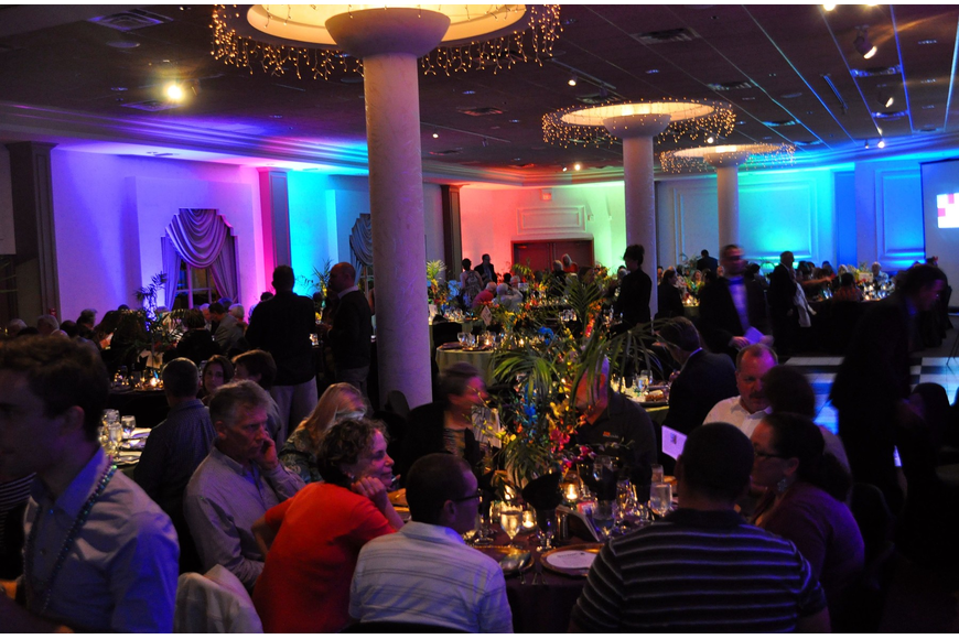 The ballroom was lit with blue, red, green, pink and purple lighting making the room festive for the Mardi Gras theme.
