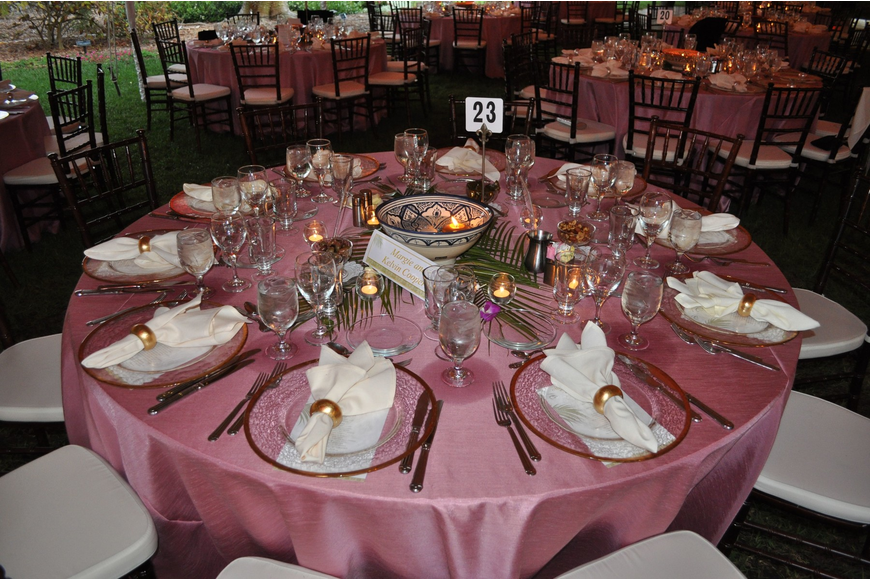 The tables were decorated with pink tablecloths and centerpiece featuring floating candles and flowers.