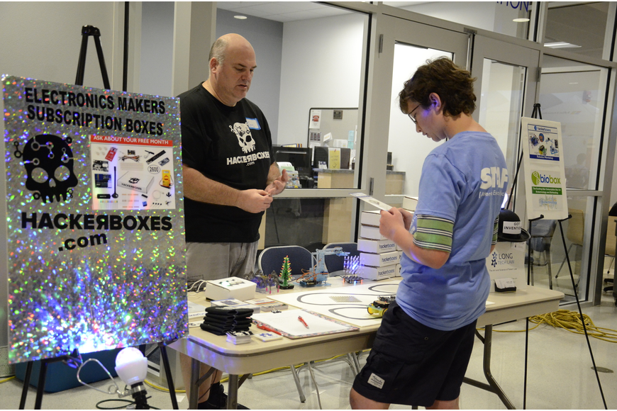 Joseph Long talks with Micah Basinger of Bradenton about his hacker boxes.
