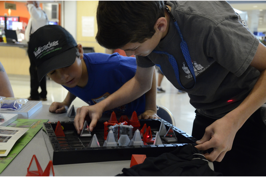 Andrew and Davis Graham of Bradenton play a game called Khet, which uses lasers to get pieces removed from the board.