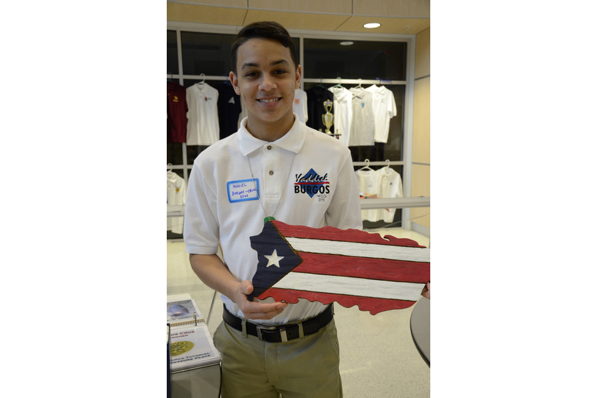 Yaddiel Burgos of Bradenton shows off his favorite piece he's made. He designs the project on Adobe Illustrator and cuts it out with a laser cutter.