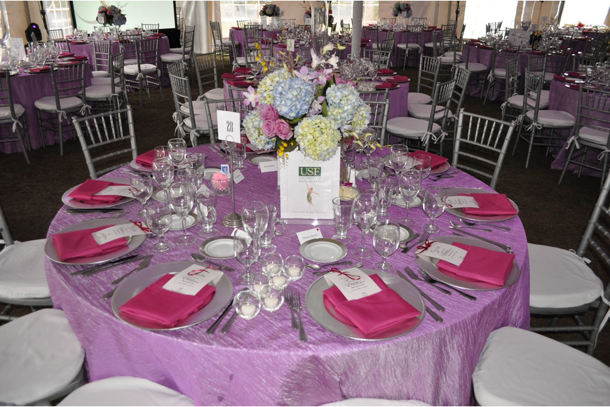 Each table was set with a lavender tablecloth, pink napkins and a vase full of hydrangeas as the centerpiece.