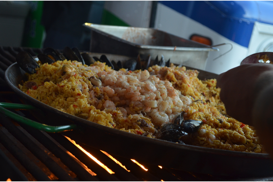 Vinnie Salvadel cooks seafood paella for the second dish.