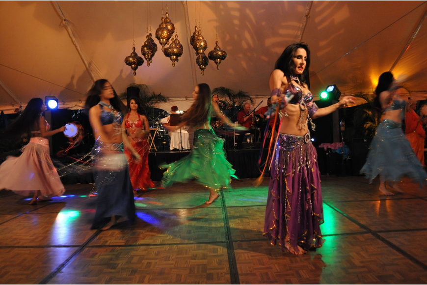 Dancers from International Productions by Tahja perform on the dance floor underneath the tent.