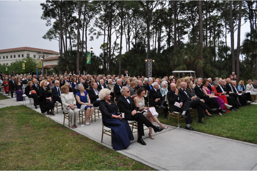 The attendees sat in chairs on the lawn of USF Sarasota-Manatee's campus to watch the performance.