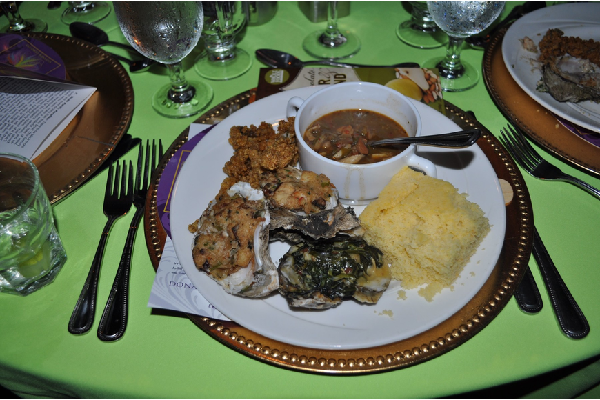 People enjoyed filling their plates up with a variety of items from the buffet line.